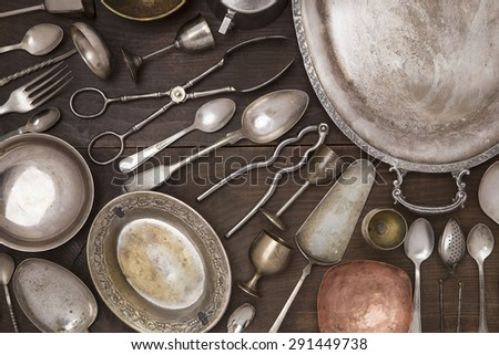 Vintage silver utensils on a wooden background - stock photo