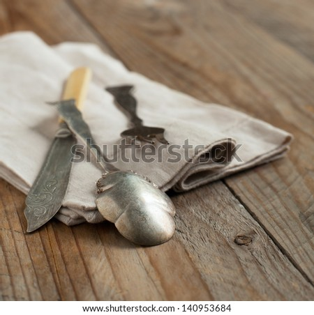 Vintage silverware on wooden background - stock photo