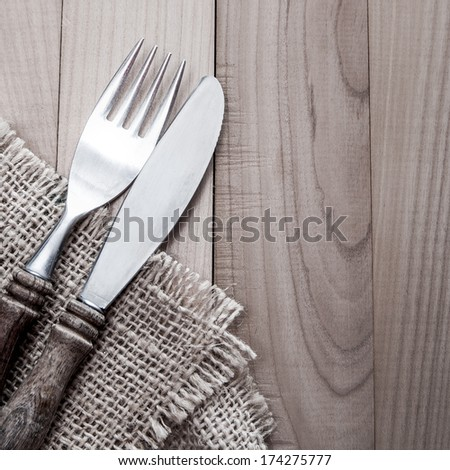 Vintage silverware on  wooden background, close up