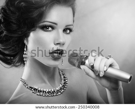 vintage Singer Girl Portrait.Singing Woman with Microphone. Vintage Style. Karaoke Song - stock photo