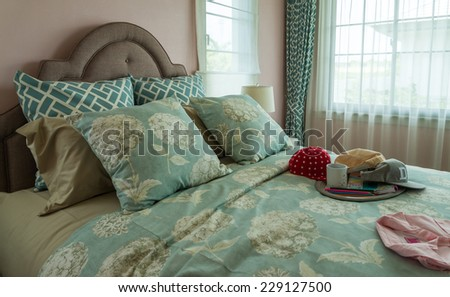 vintage single bedroom with pillows and caps - stock photo