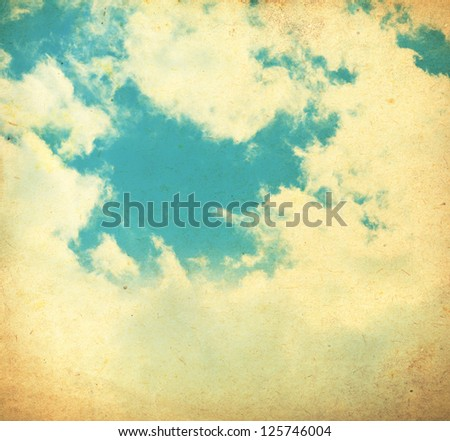 Vintage sky and clouds on old paper texture for background