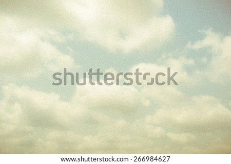 Vintage sky and soft clouds with grainy texture and vignette for backgrounds