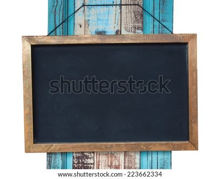 Vintage slate chalk board hanging on wooden background - stock photo