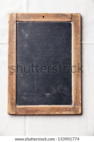 Vintage slate chalk board on textured background - stock photo