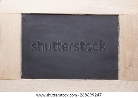 Vintage slate chalk board on textured background