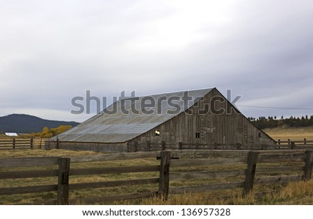 Vintage slope barn and fence in county