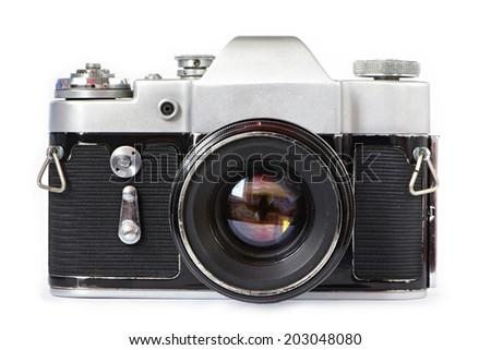 Vintage SLR camera isolated - stock photo