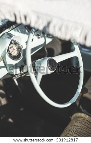 Vintage small blue car on sunlight