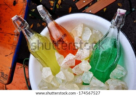 vintage soda pop bottles in a bucket of ice