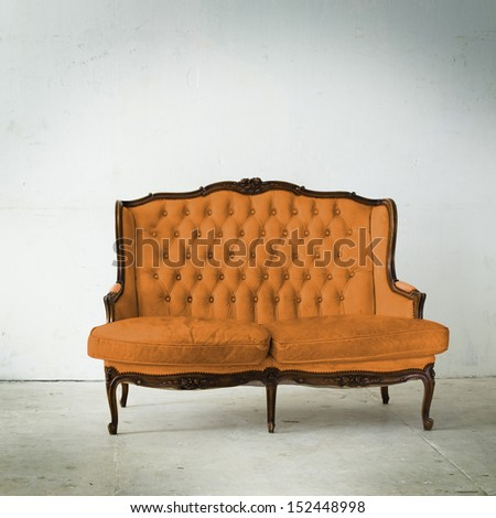 Vintage sofa in white room