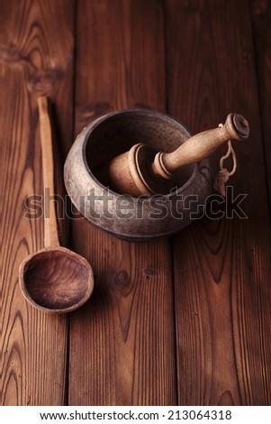 vintage sooty iron stove pot on wood - stock photo