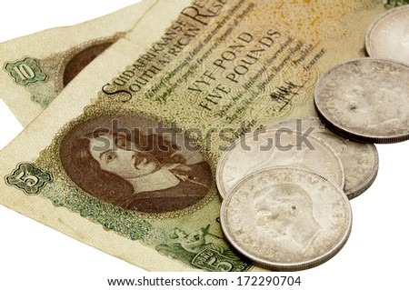 vintage 1956 south african five pound note with five shilling coins - stock photo