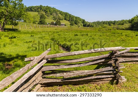Vintage Southern Virginia farm with split rail fence in foreground.  Backroads just before entering Blue Ridge Parkway. - stock photo