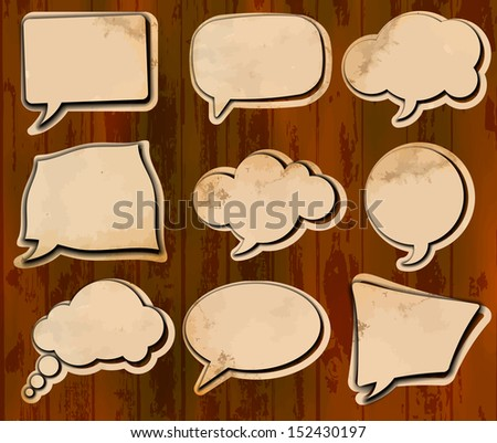 Vintage speech bubbles cut out of aged paper