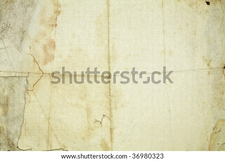 Vintage stained paper background with folds - stock photo
