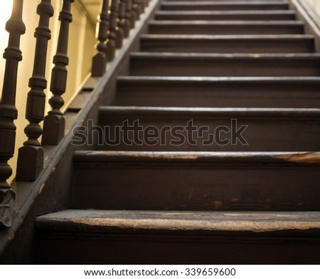 Vintage stairs, selective focus on the wooden steps. - stock photo