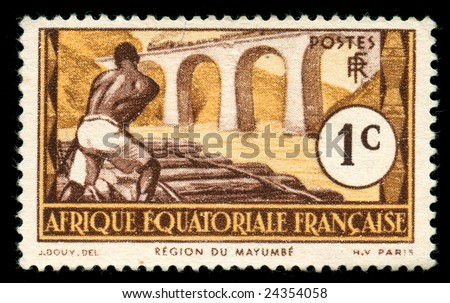 vintage stamp from Equatorial Africa now Congo, Chad, Gabon, depicting railroad worker - stock photo