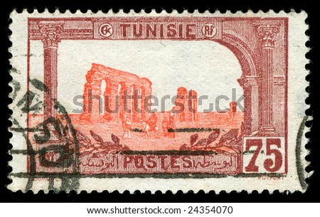 vintage stamp from Tunisia depicting Roman ruins of Carthage from the phoenician empire - stock photo