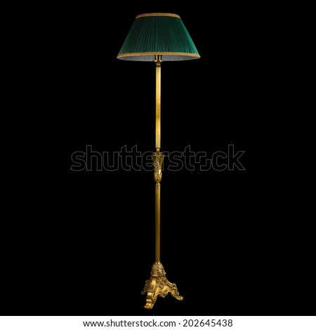 vintage stand floor lamp isolated on black  - stock photo