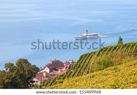 Vintage steam boat near the pier on the lake Leman (Switzerland) - stock photo