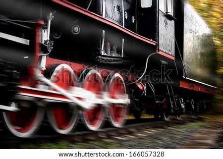 Vintage Steam engine locomotive train moving down railroad - stock photo