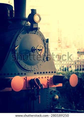 Vintage steam engine on Istanbul railway station. Old locomotive of retro train. - stock photo