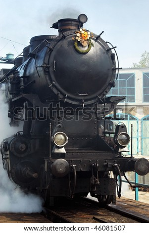 Vintage steam engine on work on the turntable - stock photo