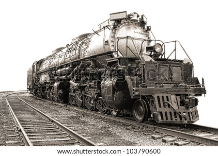 Vintage steam engine railroad freight train locomotive heavy duty type 4884 big boy on old rail tracks in nostalgic sepia - stock photo