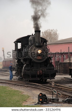 Vintage steam engine with smoke