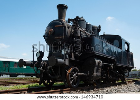 Vintage steam locomotive at station