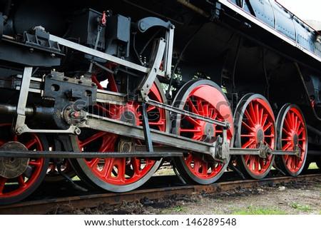 vintage steam locomotive wheels - stock photo