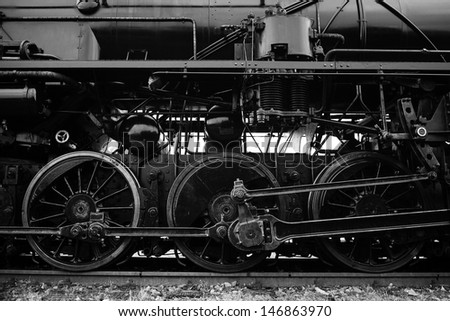 vintage steam locomotive wheels - black and white picture - stock photo