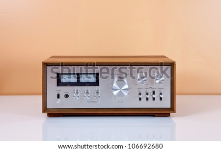 Vintage Stereo Power Amplifier in Wooden Cabinet - stock photo