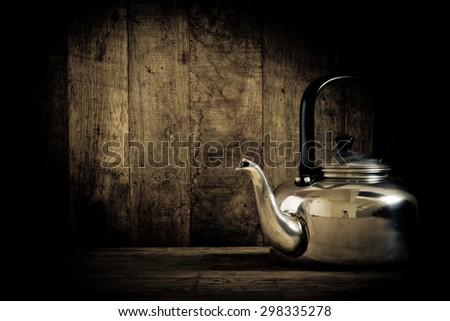 Vintage still life of old aluminium kettle - stock photo