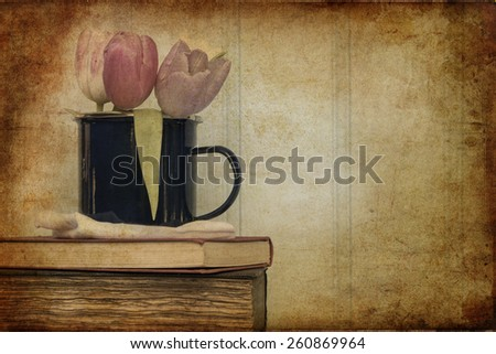 Vintage still life of Spring flowers with aged texture filter effect applied - stock photo