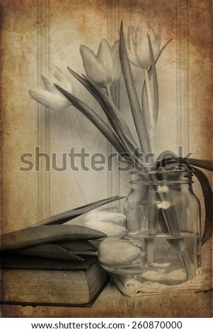 Vintage still life of Spring flowers with aged texture filter effect applied