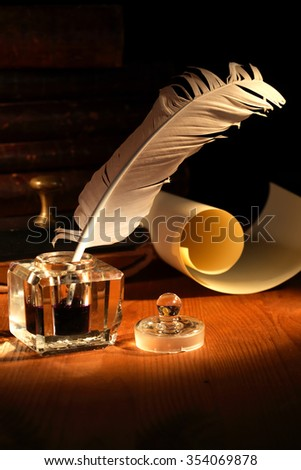 Vintage still life. Old inkstand with quill pen near scroll - stock photo