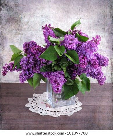 vintage still life with a branch of lilac - stock photo