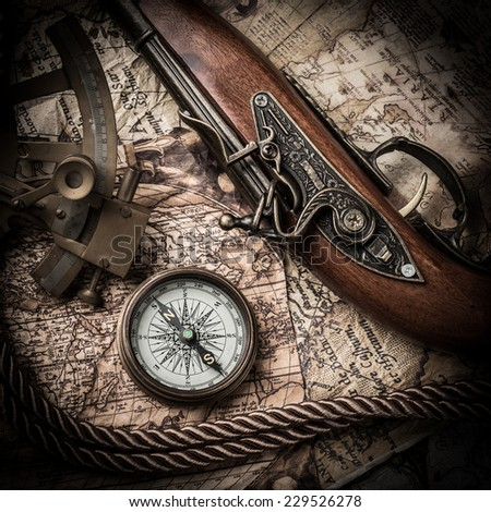 vintage  still life with compass,sextant and old map. Map source: Library of Congress. Country: Belgium Year: 1570. Author: Abraham Ortelius (1527-1598)  - stock photo