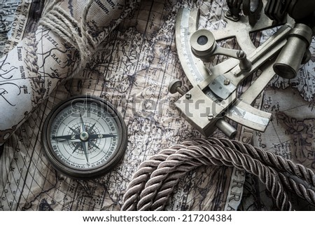 vintage still life with compass,sextant and old map.map used for background is in Public domain. Map source: Library of Congress. Country: Belgium Year: 1570. Author: Abraham Ortelius (1527-1598 - stock photo
