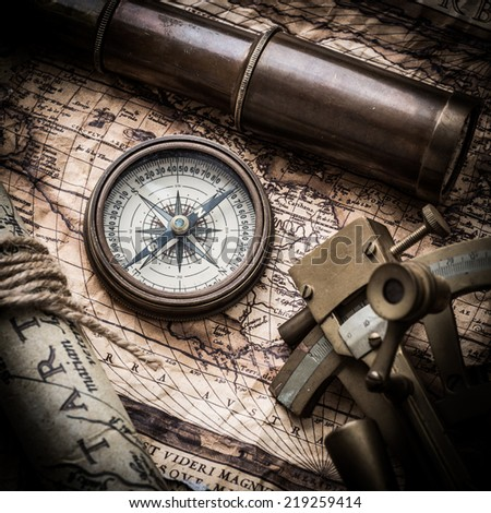 vintage  still life with compass ,sextant ,spyglass ,and old map