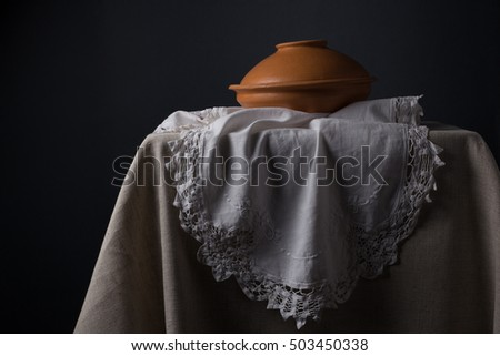 Vintage still life with lacy napkin and ceramic tableware