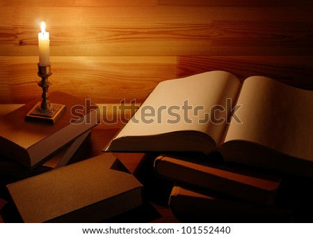 vintage still life with old books and burning candle - stock photo