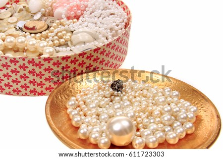 Vintage still life with pearls and jewels and medallion