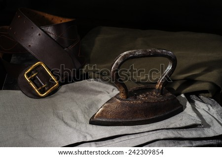 vintage still life with smoothing-iron - stock photo