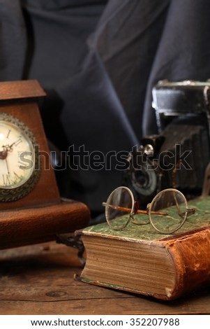 Vintage still life with various old things on dark cloth background
