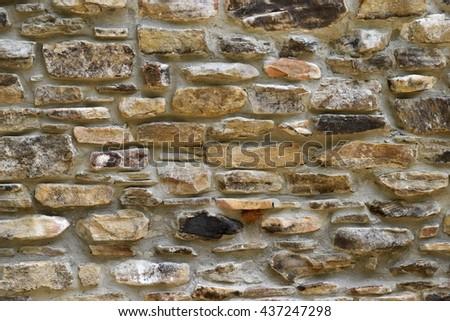 Vintage stone wall backdrop - stock photo