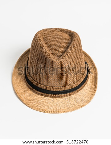 Vintage straw hat for man isolated on white.
