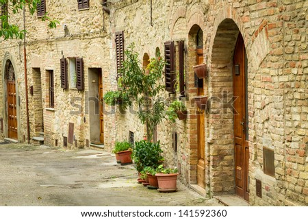 Vintage street decorated with flowers, Italy - stock photo